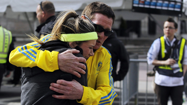 A woman is comforted by a man near a triage tent set up for the Boston Marathon after explosions went off at the 117th Boston Marathon in Boston